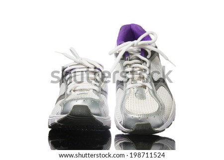 Pair of purple running shoes isolated on a white background. - stock photo