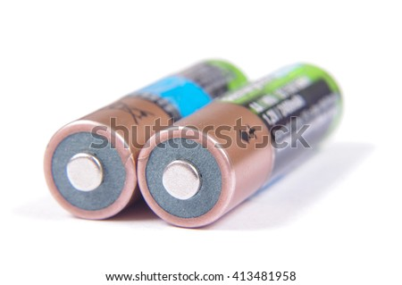 Pair of rechargeable NiMH AA batteries isolated on the white background - stock photo