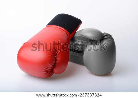 Pair of red and black and white color leather boxing gloves - stock photo