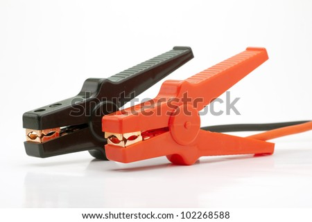 Pair of Red and Black Clamps of Jumper Cable on White Background