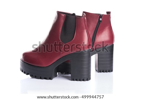 Pair of red boots for spring or autumn wear, isolated on white background