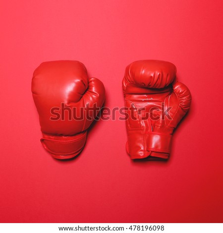 Pair of red boxing gloves on red background - Flat lay minimal design