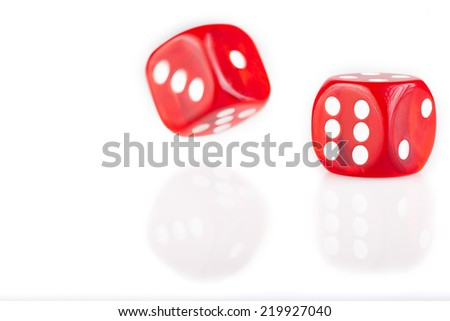 Pair of red dice isolated on white background with reflection - stock photo