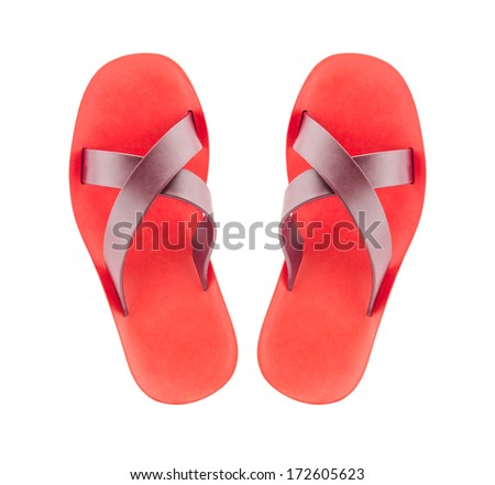 Pair of red flip-flops isolated on a white background.