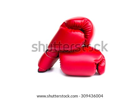 Pair of red leather boxing gloves on white background