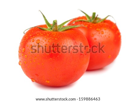 Pair of red ripe tomatoes with water drops isolated on white background