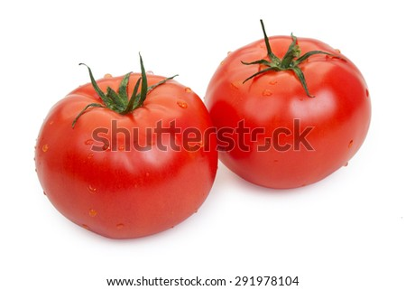Pair of red tomatoes with drops of water isolated on white - stock photo