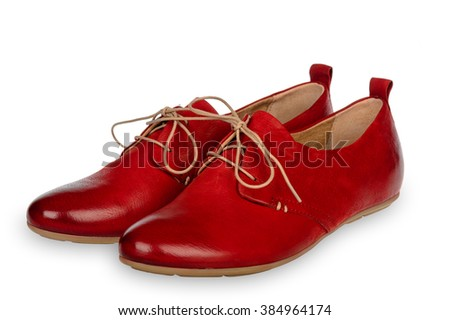 Pair of red woman shoes isolated on white background.