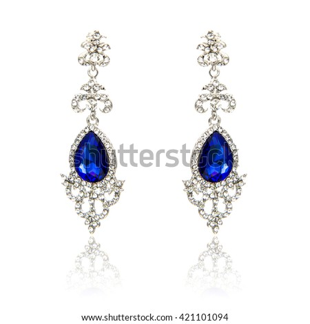 Pair of sapphire earrings isolated on white - stock photo