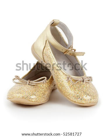 Pair of shiny golden shoes for girls on white background. - stock photo