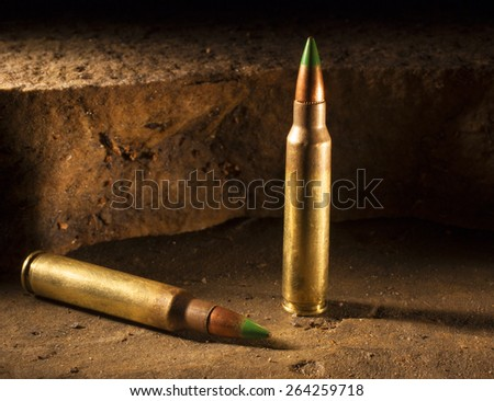Pair of small arms shells that some consider armor piercing - stock photo