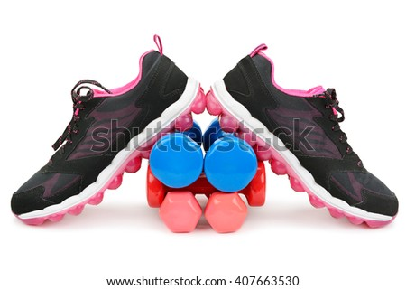 pair of sneakers and dumbbells isolated on white - stock photo