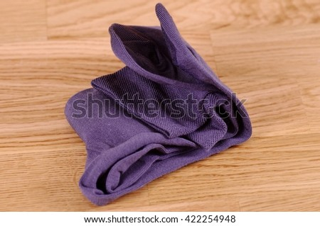 Pair of socks on the wooden background. - stock photo