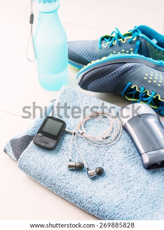 Pair of sport shoes and fitness accessories. Fitness concept