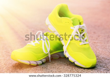 Pair of sport shoes outdoors. Toning - stock photo