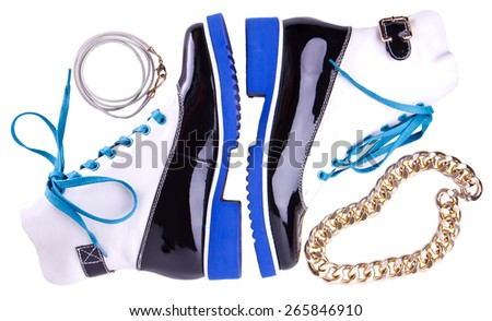 pair of stylish women's shoes with blue sole and laces, bracelets and gold chain isolated on white - stock photo
