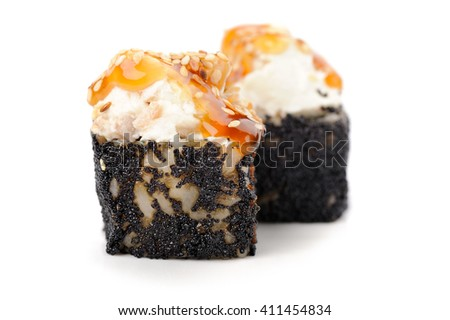 Pair of sushi rolls with cream cheese and caramel sauce in black tobiko roe isolated - stock photo