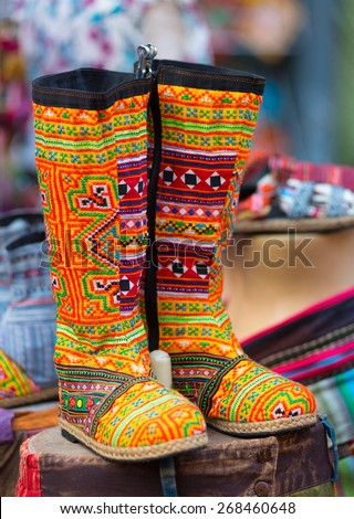 pair of Thai colourful embroidered high boots - stock photo