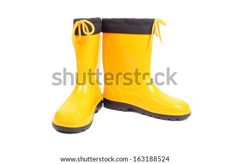 pair of the bright yellow rubber shoes - stock photo