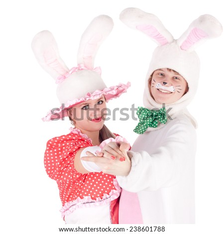 pair of the young actors dancing in the costumes of the cute bunnies - stock photo