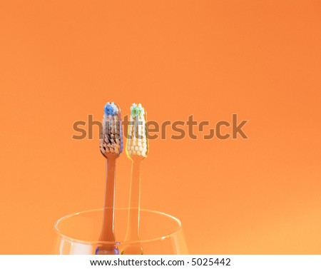 Pair of toothbrushes staring on camera. - stock photo