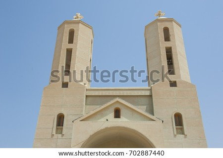 Pair Of Tower Spires On Exterior Of Modern Coptic Christian Church In  Middle East