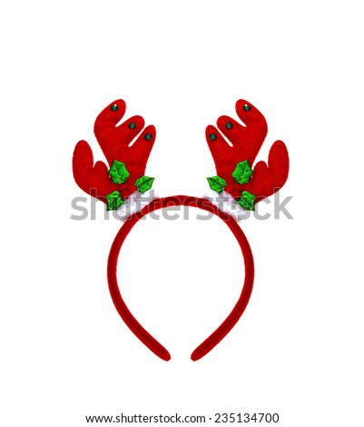 Pair of toy reindeer horns. Isolated on a white background - stock photo
