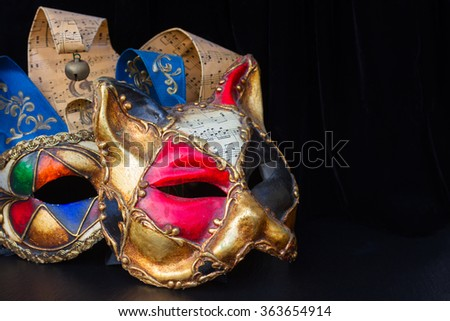 Pair of venetian Mardi gras masques of cat and jester - stock photo
