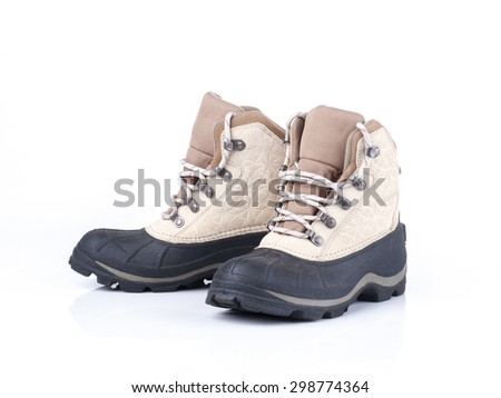pair of weather proof snow boots on white background - stock photo