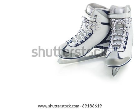 Pair of white figure skates on white background - stock photo