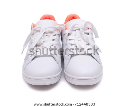 Pair of white sneakers isolated on white background. Sport shoes