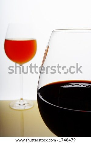 Pair of wine glasses on white background