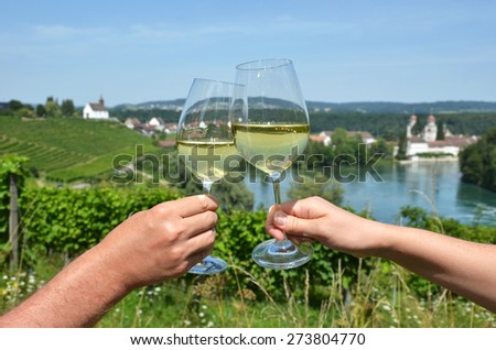 Pair of wineglasses against vineyards in Rheinau, Switzerland - stock photo