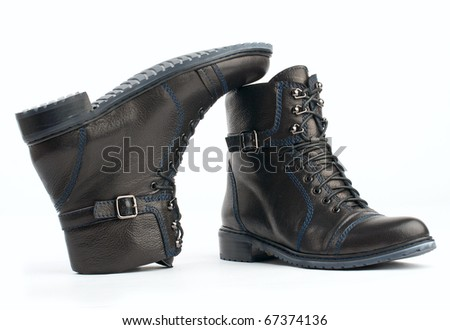 Pair of winter leather boots isolated on white background