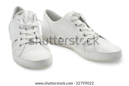 Pair of woman style sport shoes isolated with clipping path over white background - stock photo