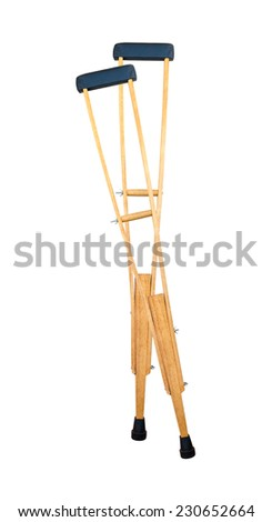 pair of Wooden crutches on white background - stock photo