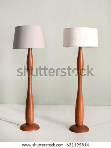 Lampshades stock images royalty free images vectors shutterstock pair of wooden floor or standing lamps with a curving sinuous shape and neutral colored cylindrical mozeypictures Images