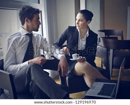 pair of workers talking in coffee break - stock photo