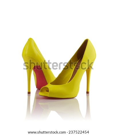 Pair of yellow modern fashionable women shoes shot in studio - stock photo