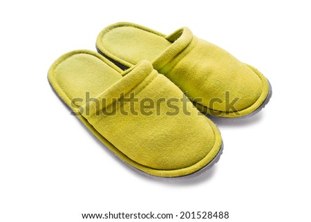 Pair of yellow soft slippers isolated over white - stock photo