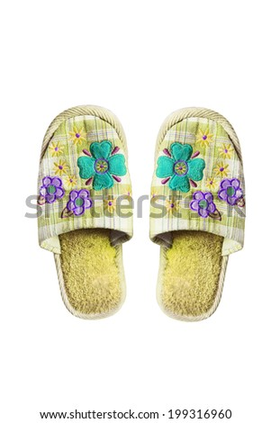 Pair of yellow textile slippers isolated over white - stock photo