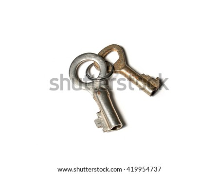 pair small old metal keys on keyring on white background