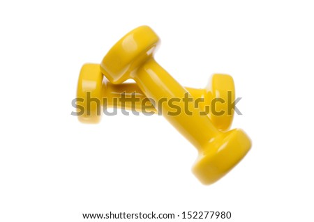 Pair small yellow dumbbells isolated on white background - stock photo