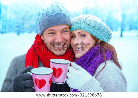 pair warming up with hot cups - stock photo