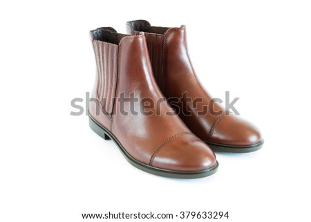 pair women's leather boots - stock photo