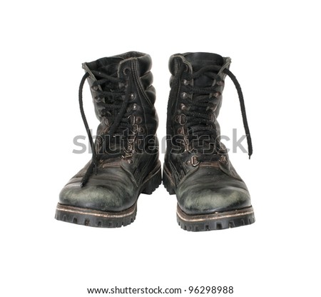 Pair worn army boots it is isolated on a white background. - stock photo