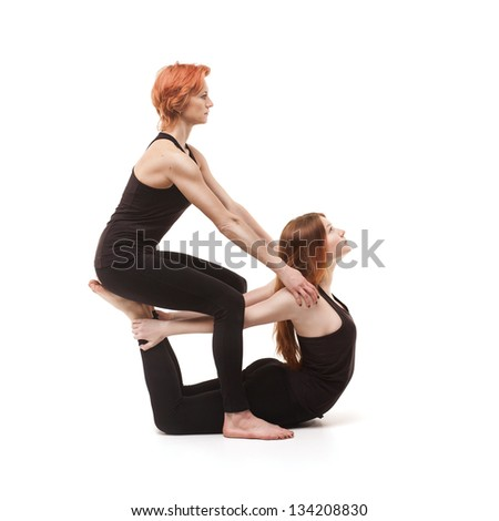Paired yoga two women practicing yoga on a white background stock