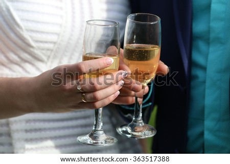 pairs of hands with glasses of wine