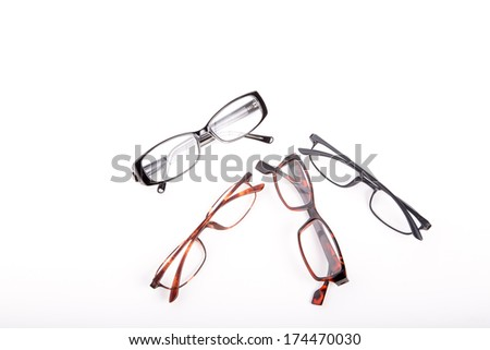 Pairs of reading glasses on a white background - stock photo