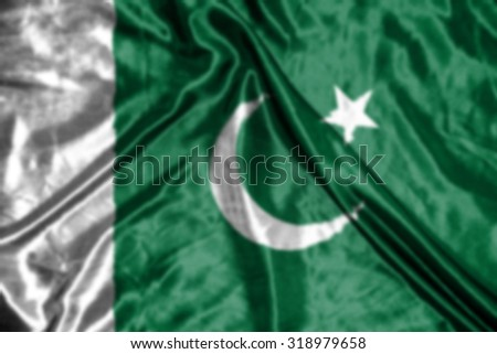 pakistan flag,abstract blurred background - stock photo